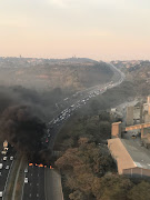 Traffic was gridlocked on the N2 northbound in Durban after protesters blocked the road with burning tyres.