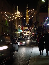 Photo: The Rue St-Dominique near our hotel is decorated with Eiffel Tower lights, with the real thing in the background.