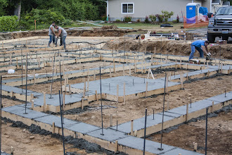"""Photo: After we pour walls, there will be a 4"""" rat slab poured in the crawl.  The foundation will be waterproofed and ventilation will be provided by timed exhuast."""