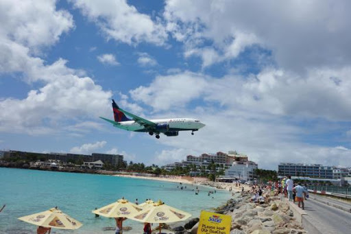 At Maho Beach, a Delta plane comes in for a landing at one of the Caribbean's most famously adrenaline-inducing spots.