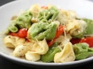 Seafood Diablo with white sauce and tortellini