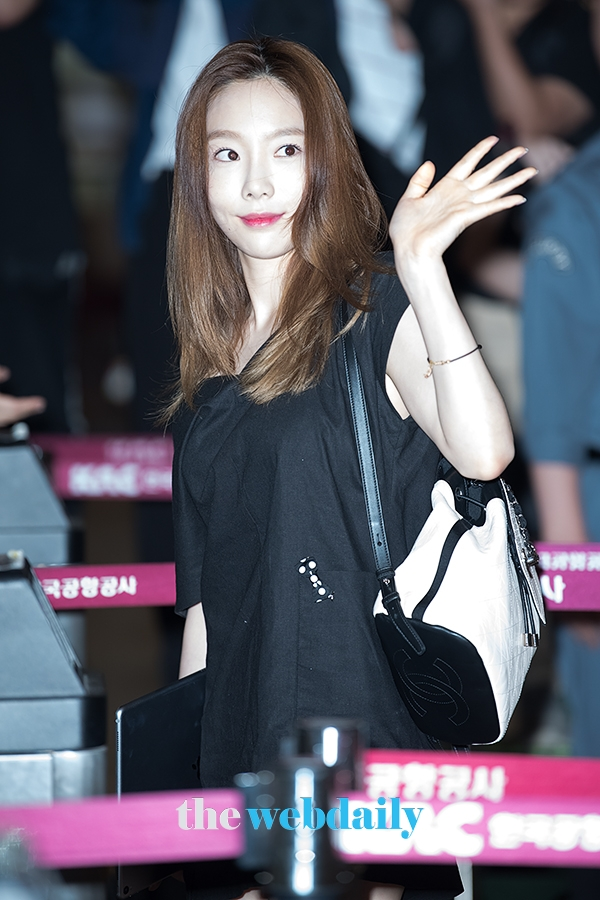 taeyeon airport sad 8