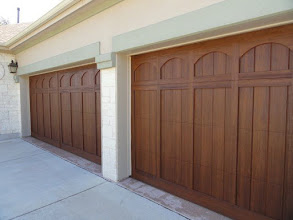 Photo: Wood Free Door. Elaborate Arch design. Factory paint color selected. Sizes 16 x 7 and 8 x 7. R9 insulation. Big improvement over the rotting wood door we replaced.