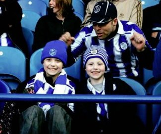 Photo: Ellie, Josh and Dad Carl. One of the PACT families enjoying a day out at Hillsborough