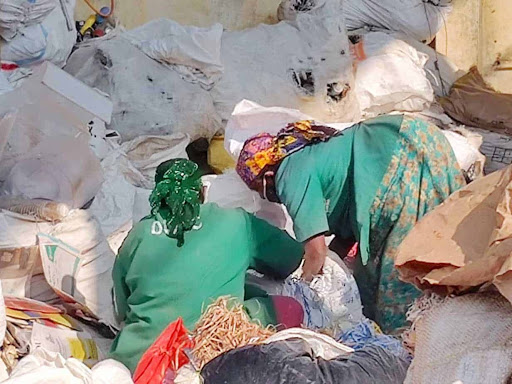 How has Bengaluru fared in empowering waste workers?