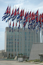 Photo: flags blocking view of electronic message screen on outside of u.s. interests section, havana, cuba. Tracey Eaton photo.