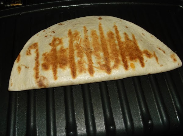 Place as many prepared tortillas on grill as space allows; lower lid and press...