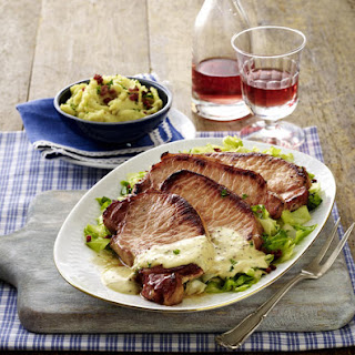 Pork Chops with Mashed Potatoes and Slow-Cooked Cabbage.
