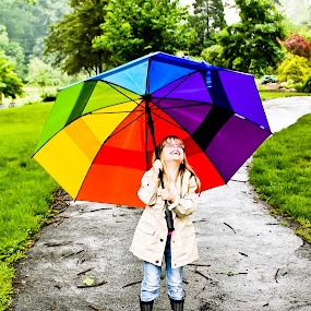 A Rainy Day by Brooke Beauregard - Babies & Children Children Candids ( umbrella, play, rainbow, rain, outside,  )