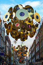 Photo: Carnaby Street Rock 'N Roll Christmas - London, U.K.  Carnaby Street in London's Soho District goes Rock 'N Roll for Christmas, featuring the Rolling Stones.  For their 50th Anniversary, Carnaby has collaborated with the popular band for their Christmas installations. These consist of huge 3D spheres containing gold and silver vinyl records emblazoned with the band's iconic artwork and album covers. These can be seen suspended throughout the street.  #CarnabyStreet   #Christmas   #RollingStones   #RockNRoll     #London   #England   #UK   #GreatBritain      #Travel   #Photography   © Yen Baet - www.YenBaet.com. All Rights Reserved. Join me on Facebook at www.facebook.com/YenBaetPhotography.