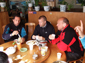 Photo: Lunch in Nyalam, Tibet (r to l) Fedirico, Marko, Willem, Samuli's hand...gesturing for another beer.