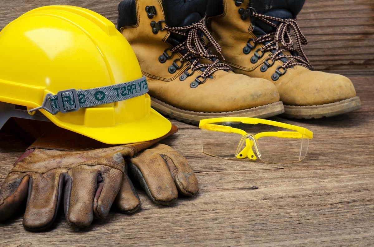 Construction safety equipment on a wooden surface.jpg