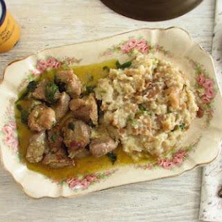 Pork with Portuguese migas (crumbs).