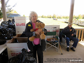 "Photo: Letha Grace McCoy, the Toys for Tots Coordinator, with a teddy bear gift a child brought in for ""Toys for Tots"".  Gary McCoy sitting.   HALS Public Run Day 2015-1121 2:01 PM    © 2015 Rick White"