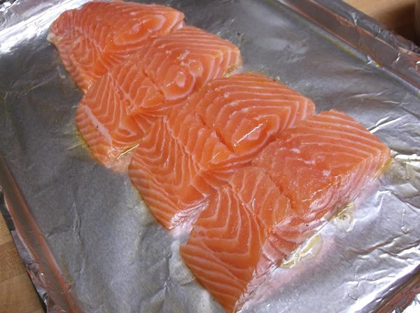 Place salmon portions on prepared baking sheet.