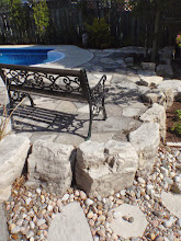Photo: Armor stone and natural flag with river rock add natural beauty to this pool surround.
