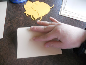 Photo: making sure the edges line up before creasing.
