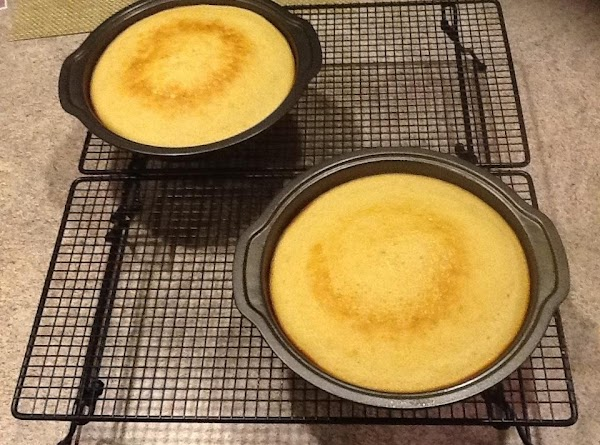 Set on cooling racks for 15-20 minutes then remove from pans. Peel wax from...