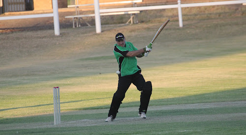Crossroads Hotel's Mark Fielder in action at Collins Park on Saturday evening in his side's 17-run win against RSL.