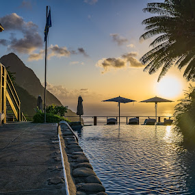 Beautiful view of the Pitons by Justin Hyder - Buildings & Architecture Other Exteriors ( sunrise, tourism, holiday, mountain view, sea, summer, beautiful, swimming, bali, caribbean, mountain, view, romantic, hotel, vacation, resort, sky, nature, pitons, umbrella, island, relax, pool, tranquil, water, outdoor, tropical, blue, background, beach, st. lucia, sunset, luxury, paradise, infinity, travel, landscape, villa )