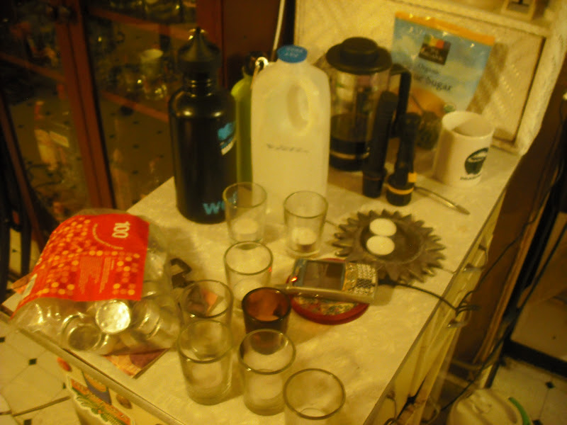Photo: Some extra water, candles, phone on charge, flashlights