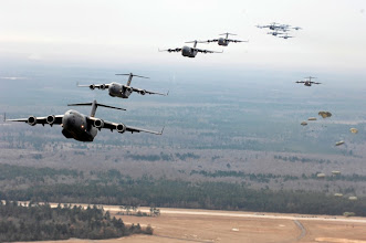 Photo: Twenty U.S. Air Force C-17 Globemaster IIIs fly over Charleston, S.C., Dec. 21, 2006.  The C-17s, assigned to the 437th and 315th Airlift Wings at Charleston Air Force Base, S.C., were part of the largest formation in history from a single base and demonstrated the strategic airdrop capability of the U.S. Air Force. (U.S. Air Force photo by Senior Airman Richard W. Rose Jr.)