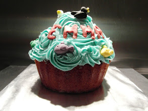 Photo: Vanilla giant cupcake with blue piped buttercream and fondant decorations