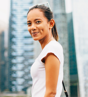 Woman Smiling Buildings