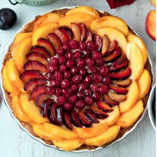 Gluten-Free Peach, Plum, Raspberry Tart with Cardamom Cream and Almond Crust