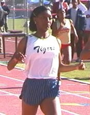 Monique Henderson completes her 100/200 Mt SAC double in 2001. John Dye Photo.