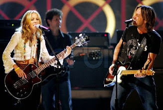 """Photo: Australian country artist Keith Urban (R) performs his song """"Days Go By"""" with artist Sheryl Crow (L) on stage at the 2004 Billboard Music Awards held at the MGM Grand Garden Arena at the Las Vegas MGM Grand Hotel & Casino. December 8, 2004 Las Vegas, Nevada, USA"""