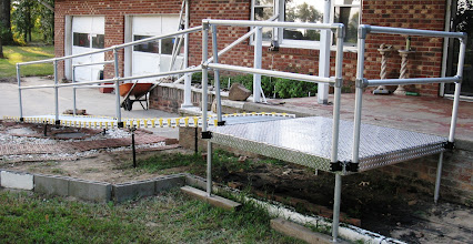 Photo: This ramp set up provides access down to the driveway without blocking the stairs.