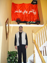 Photo: Syed Qamar Iqbal at Ali Rizvi's residence under piece of Hazrat Abbas Ghazi's flag once raised at His Roza-e-Mubarrak.