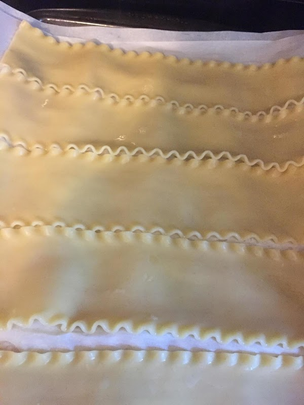Cook Lasagna noodles per instructions on box. I layer cooked moodles between parchment paper...