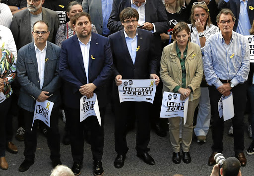 Jordi protest: Catalan President Carles Puigdemont, third from left, joins a demonstration in Barcelona after the jailing of pro-independence leaders Jordi Sanchez and Jordi Cuixart. Picture: REUTERS