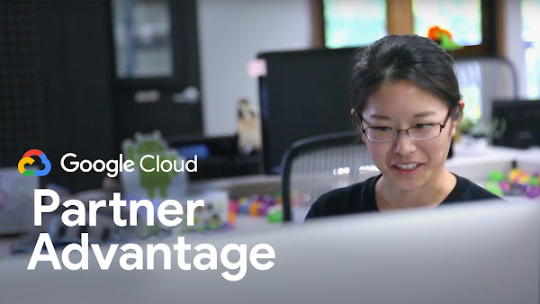 Woman sitting in front of computer with Partner Advantage logo overlaid on top of image.