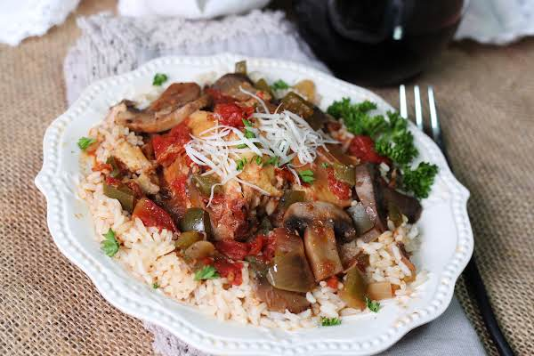 Slow Cooker Chicken Cacciatore With Parmesan Sprinkled On Top.