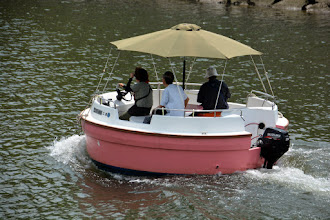 Photo: A really weird boat on the river through the park
