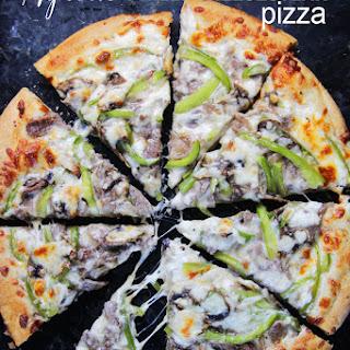 Alfredo Philly Cheesesteak Pizza.