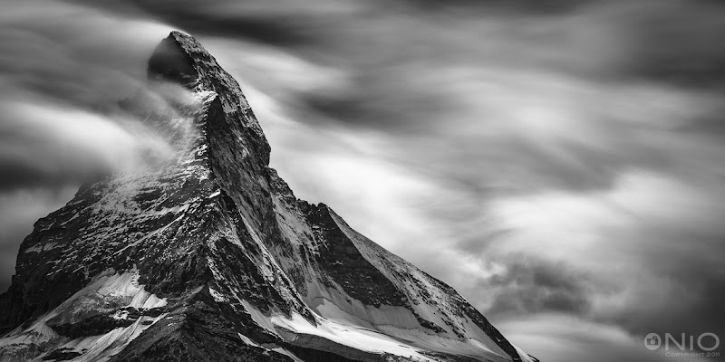 Photo: Matterhorn Long Exposure In B&W From my blog: http://www.niophoto.com/matterhorn-long-exposure-in-bw/  I was in Zermatt, Switzerland, for a few days last week. Amongst others, I was there for a photo walk with the +Swiss Photography Club G+, as well as a climb up to the summit of the Breithorn (4,164 m / 13,661 ft) with +Wilfried Haferlandand +Deborah Vos… pffff. The most dominant peak in the Zermatt region is the Matterhorn. Its summit is 4,478 metres (14,690 ft) high, making it one of the highest peaks in the Alps. It also one of the most photographed mountains of the world, so it is hard to come home with something original.  During one of my hikes last week, the cloud formations around the Matterhorn looked interesting enough to try something different: a long exposure. As it was quite sunny, I combined 3 Lee ND filters (10 + 3 + 2) to get to 15 stops of exposure reduction and with that an exposure time of 2 minutes. I processed the image in Lightroom 4.1 and Silver Efex Pro 2. I like the result of this experiment. Hope you do to!  Dedicating this one to +Yasmin Simpson. One of the nicest persons I have met here on G+ and a great artist, so make sure to go circle her!  Btw: shot this with a D800E instead of the trusted D3x. The D800E is really growing on me :)  #BWFineArtLE by +Joel Tjintjelaar,  #BreakfastClub +Breakfast Club by +Gemma Costa,  #PlusPhotoExtract by +Jarek Klimek #swdpcl by +peter paul müller,  #MinimalMonday by +Olivier Du Tré #monochromeMonday by +Manuel Votta +Charles Lupica+Nurcan Azaz+Jerry Johnson  #mountainmonday by +Michael Russell,   #LandscapePhotography +Landscape Photographyby +Margaret Tompkins, #10000photographersaroundtheworld +10000 PHOTOGRAPHERSby +Robert SKREINER ,  #AerialPhotography +AerialPhotographyby +Markham Lane #mountainphotos  +Mountain Photos #spcfeature #photography #potd  #bwfineart  #bwphotography  #D800E