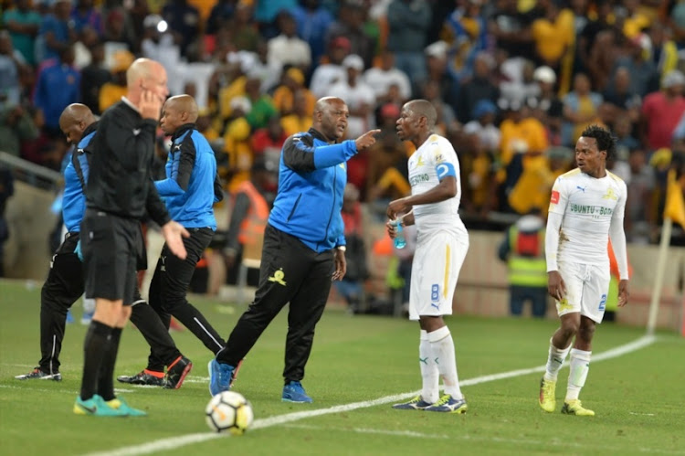 Pitso Mosimane and Hlompho kekana of Mamelodi Sundowns during the Absa Premiership match between Kaizer Chiefs and Mamelodi Sundowns at FNB Stadium on January 27, 2018 in Johannesburg.