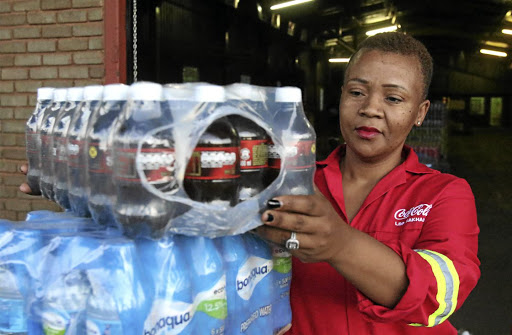 Verda Maluleka stands outside a warehouse she owns in Louis Trichardt, Makhado, which deals with the distribution of Coca-Cola beverages. / ANTONIO MUCHAVE
