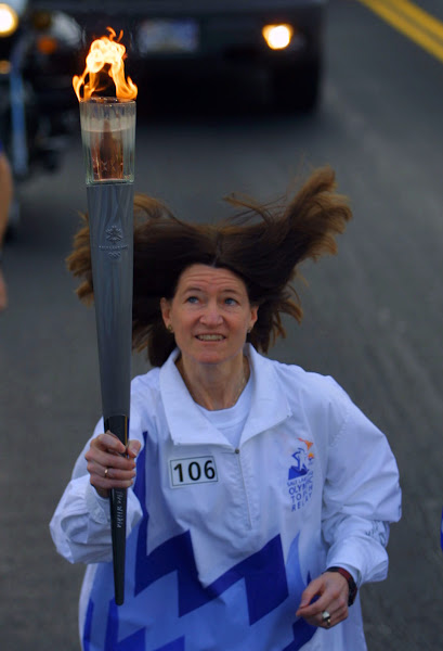 Photo: 14 Jan 2002: Torchbearer Sally Ride carries the Olympic Flame during the 2002 Salt Lake Olympic Torch Relay in San Diego, California. DIGITAL IMAGE.  Mandatory Credit: Todd Warshaw/Pool/Getty Images