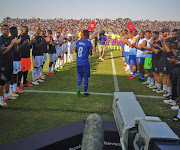 Cape Town City midfielder Teko Modise receives a guard of honor from his teammates and Black Leopards players in his last match as a professional in Thohoyandou, Venda, on Saturday May 11 2019.