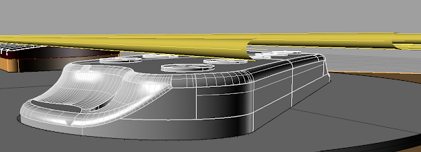 Photo: It follows the fingerboard radius. I don't think it will be directly noticeable, but should create a smooth gradient over it. Can't wait to do a pickup shot.