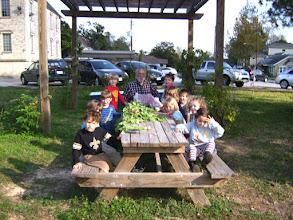 Photo: Vance and CDC kids enjoying their radish harvest 12/1/11