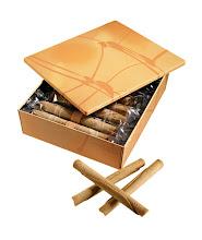 Photo: YOKU MOKU Gold tin of 20 cigar-shaped café au lait butter cookies. $28. Japan. Seventh Floor. 212 872 2758