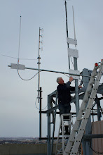 Photo: Mark VE4MAB mounting the 2 meter omni directional antenna to the structure