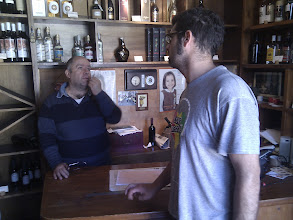 Photo: a knowledgeble shopkeeper of the Cava is puzzled by where to find best olive oil on the island