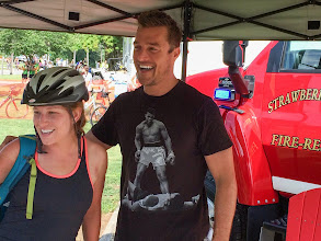"""Photo: Arlington farmer and recent """"Bachelorette"""" competitor Chris Soules, 32, posed for photos and shook hands with RAGBRAI riders as a fundraiser for the Strawberry Point Fire Department."""